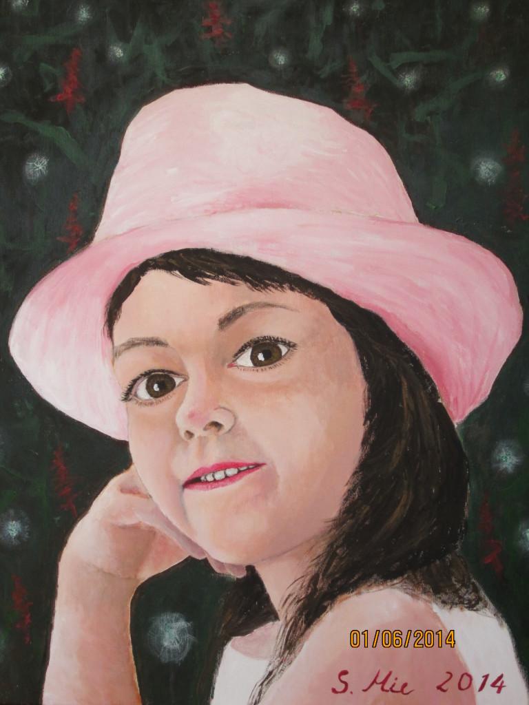 Mädchen mit rosa Hut